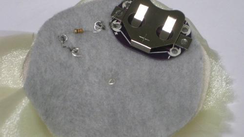 http://sparkfun.com/tutorial/BentLEDTutorial/batterytoresistortiny.jpg